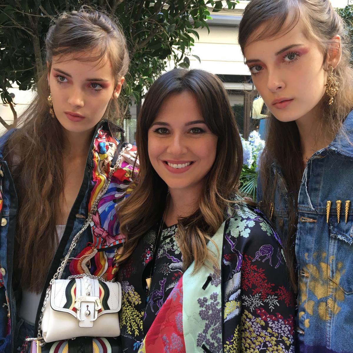 The designer Paula Cademartori in between two of her models in Milan during the ss2017 presentation